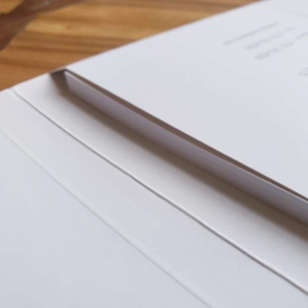 Custom embossed tax folders